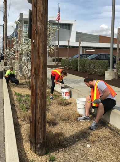 VOLUNTEER WEEK: City Hall crew cleans up litter downtown
