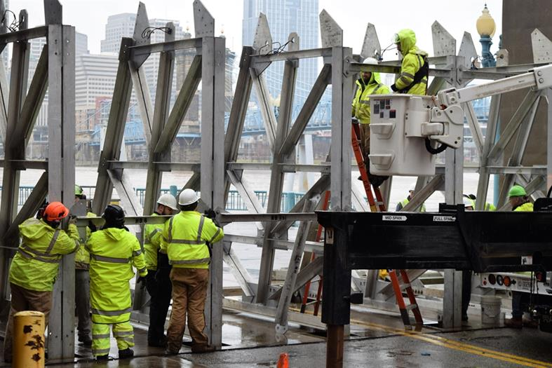 Piece by piece, a floodgate takes shape